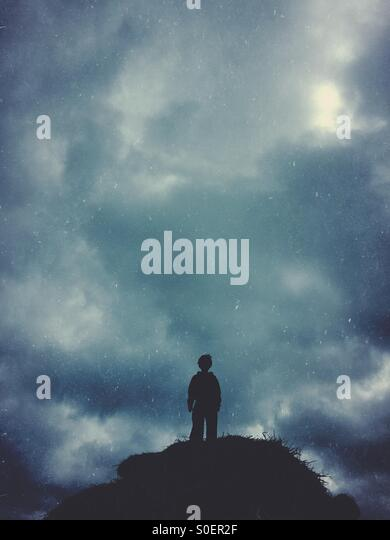Boy on the hill - Stock Image