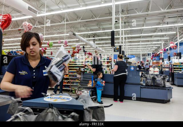 Florida FL New Port Richey Walmart discount department store inside shopping checkout woman employee cashier - Stock Image