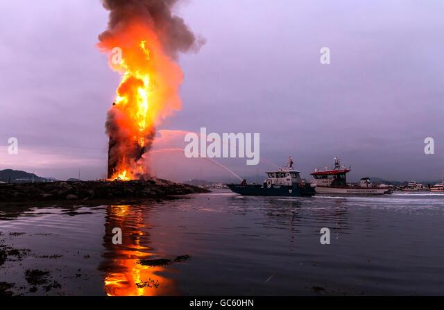 Rescue vessels safeguarding the burn down of 47,4 meter world record bonfire at Slinningen, Ålesund, Norway - Stock Image