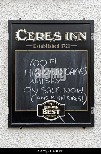Restaurant sign displaying 700th Highland Games Whiskey, Ceres Inn Restaurant, Ceres, Scotland, United Kingdom - Stock Image