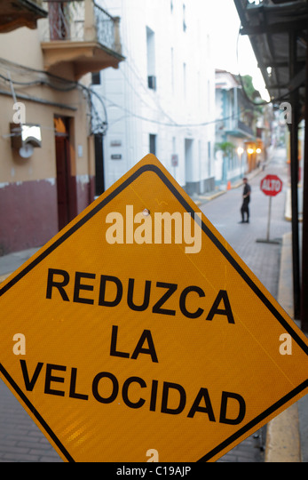 Panama City Panama Casco Viejo San Felipe neighborhood traffic sign yellow diamond shape reduce speed reduzca la - Stock Image