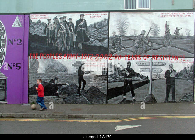 Shankill Road Mural -90 years of resistance, West Belfast, Northern Ireland, UK, with boy kicking football - Stock Image