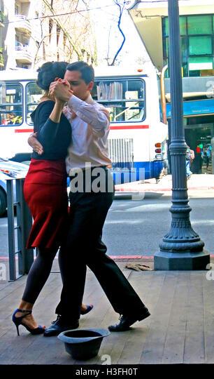 a couple dancing tango in street Montevideo Uruguay - Stock Image