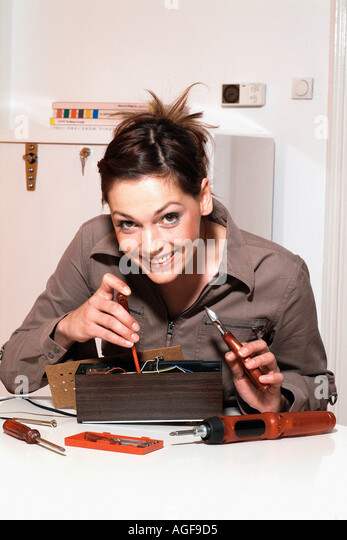 Young woman with fuse-box - Stock Image