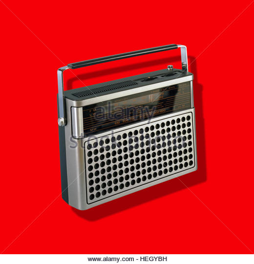 Portable Radio Vintage Music Player kitsch retro hand held isolated mid century  on plain background - Stock Image