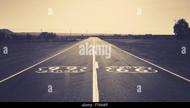 Old film retro dark toned photo of Route 66, California, USA. - Stock Image