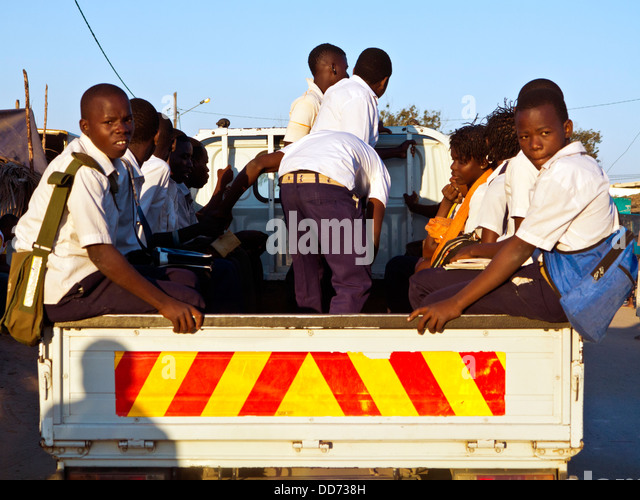 Mozambique, Nampula Province, schoolchildren in vehicle. - Stock Image