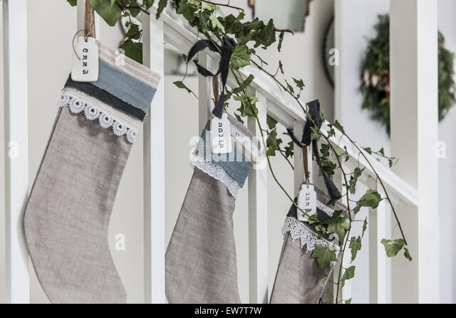 Christmas stockings with homemade nametags - Stock Image