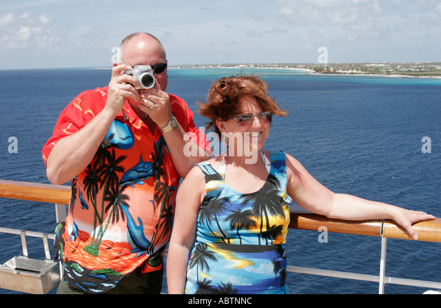 Grand Turk Turks Island Passage Cockburn Town Holland America Line ms Noordam passengers couple camera - Stock Image
