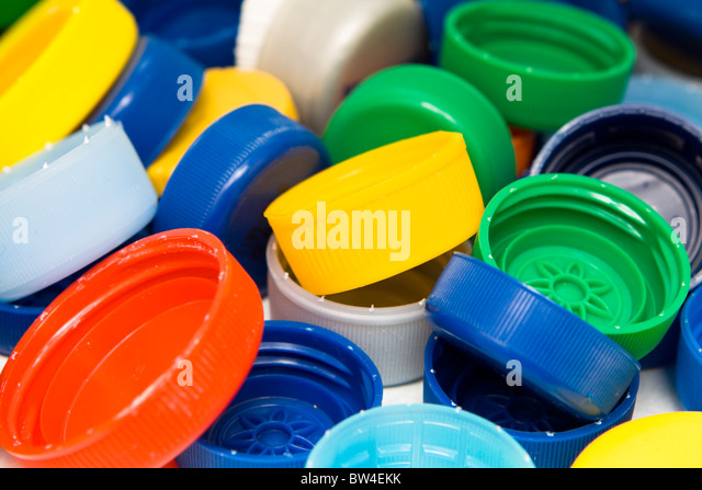 Lots of colorful plastic caps. Shot in studio. - Stock-Bilder
