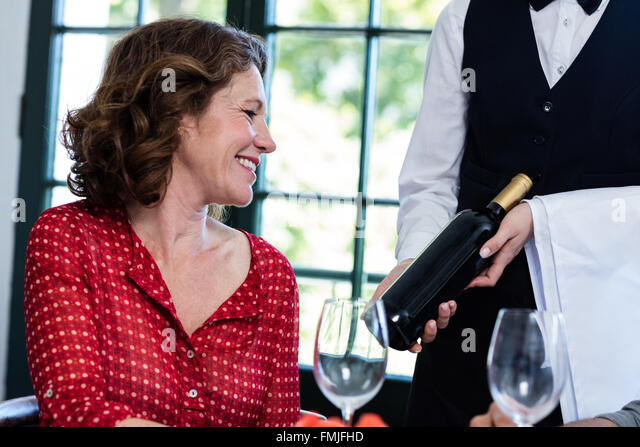 Woman selecting a bottle of wine - Stock Image
