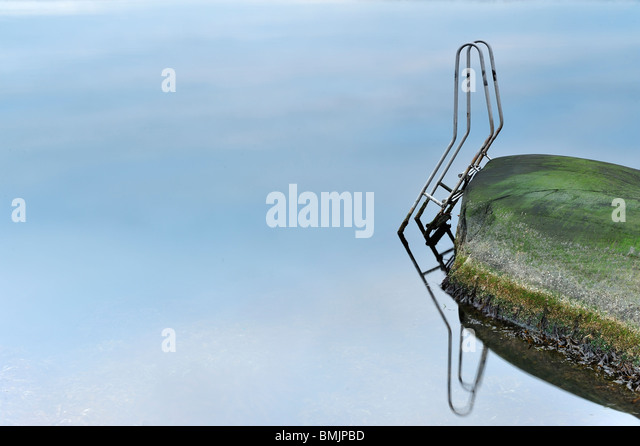 Scandinavia, Sweden, Gothenburg, Reflection of ladder in sea - Stock Image
