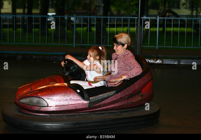 mother and daughter drive electric car - Stock Image