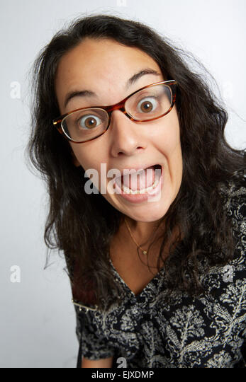 Portrait of Woman Making Funny Faces - Stock Image