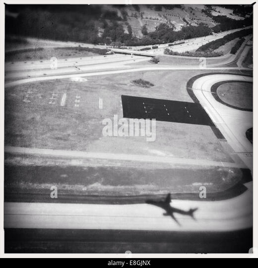 Shadow of plane over airport - Stock Image