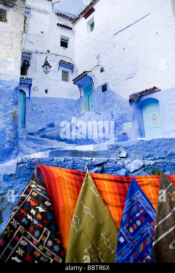 Rugs Hanging on a wall, Chefchaouen, Morocco, North Africa - Stock Image