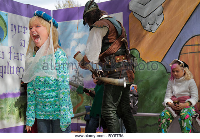 Florida Deerfield Beach Quiet Waters Park Florida Renaissance Festival girl screams stage costume - Stock Image