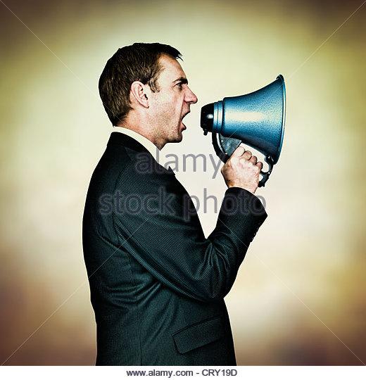 shouting orders - Stock Image