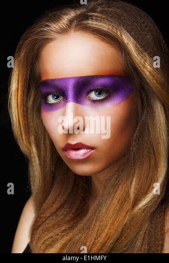 Fantasy. Coloring. Trendy Woman with Shiny Colorful Makeup. Faceart - Stock Image