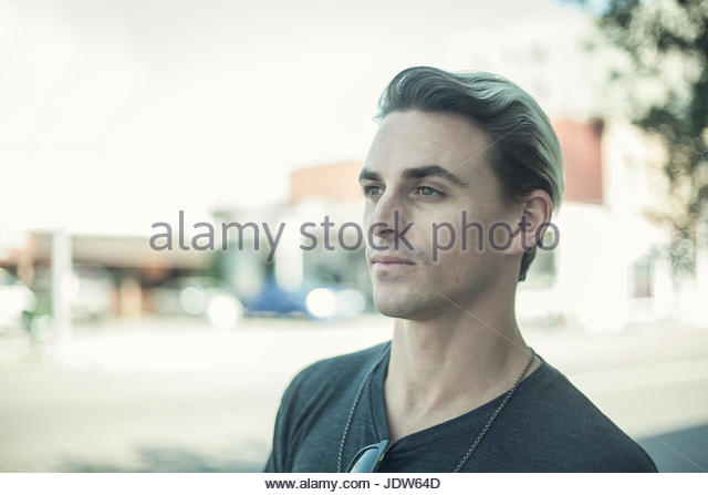 Portrait of young man, looking away - Stock-Bilder