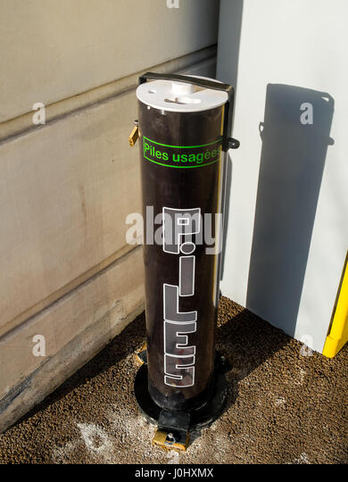 Public dispenser for old batteries - France. - Stock Image