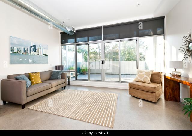 Living room with sliding glass door to balcony - artwork from photographer portfolio - Stock Image