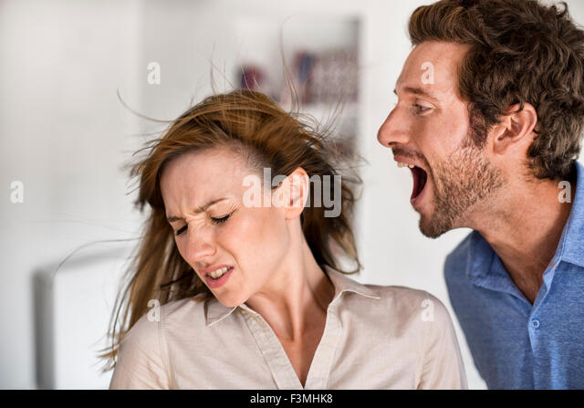 Angry man. He yells at his wife - Stock Image