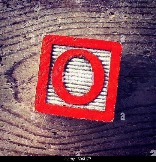 It's a woodblock toy with an alphabet letter on it: Q - Stock Image