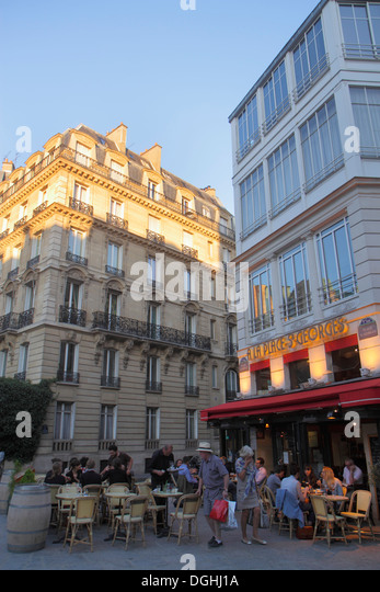 Paris France Europe French 9th arrondissement Place St. Saint Georges restaurant cafe brasserie alfresco tables - Stock Image