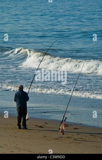 Surf fishing rod stock photos surf fishing rod stock for Santa barbara fishing charters