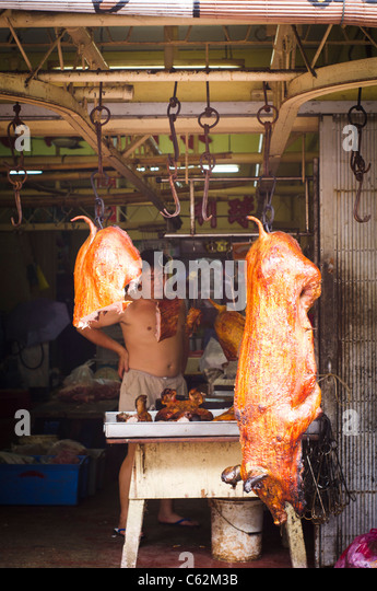 roaster pig was hanging in front of the shop, Penang, Malaysia. - Stock-Bilder