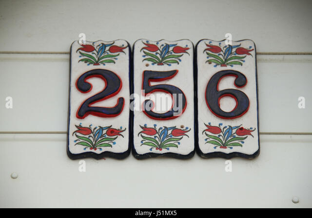 Bournemouth, UK -  13 May: Colourful number plaques on a Bournmouth beach hut. General view of the seaside town - Stock Image