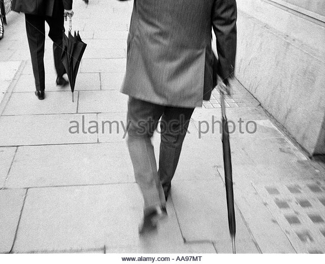 Two business walking down Cheapside, City of London UK - Stock Image
