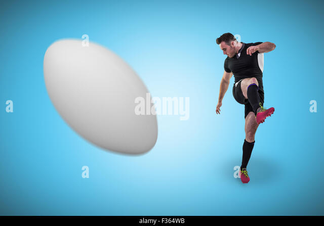 Composite image of rugby player kicking - Stock Image