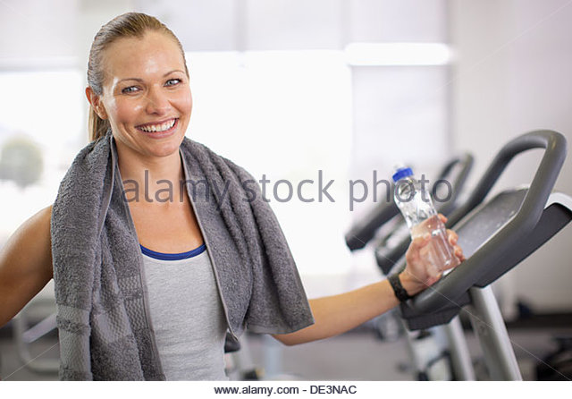 Woman with bottled water in gym - Stock Image