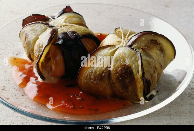 Salmon wrapped in eggplant with tomato coulis - Stock Image