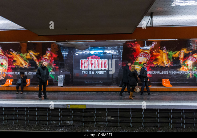 Paris, France, inside Metro Station, People Waiting on Quay, with French Advertising, billboards for local Beer, - Stock Image