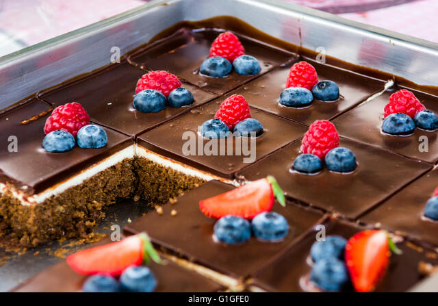 Tasty chocolate pastry with fresh berries. - Stock Image