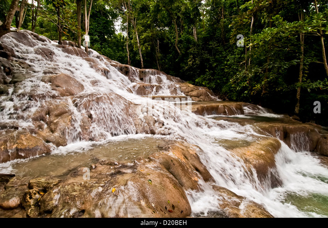 Dunns River Falls with trees in background, no people, Jamaica national symbol Ocho Rios Jamaica - Stock Image