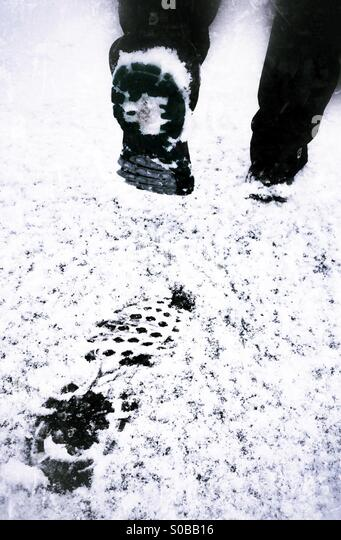 Footsteps in the snow. - Stock Image