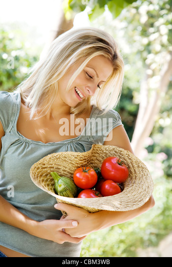 female in the garden - Stock Image