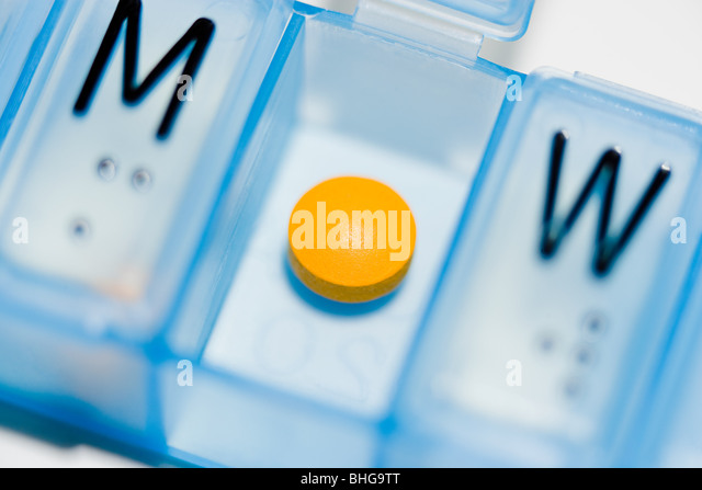 Pill in a pillbox - Stock Image