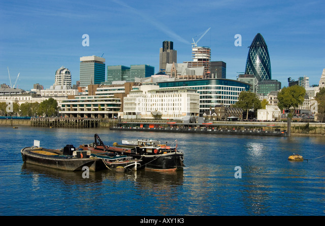 Archival of The City of London in November 2006 from the south bank on the river Thames with blue sky - Stock Image