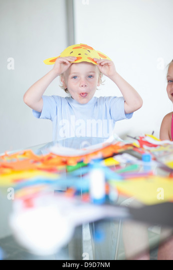 Children's mask making party - Stock Image