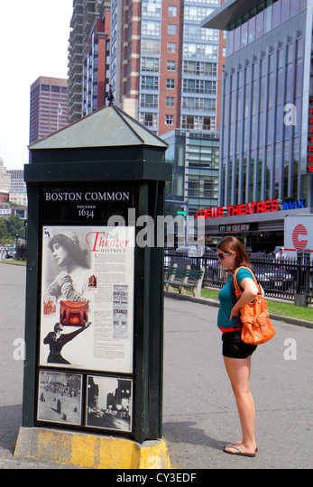 Boston Massachusetts Tremont Street Boston Common kiosk information woman reading - Stock Image