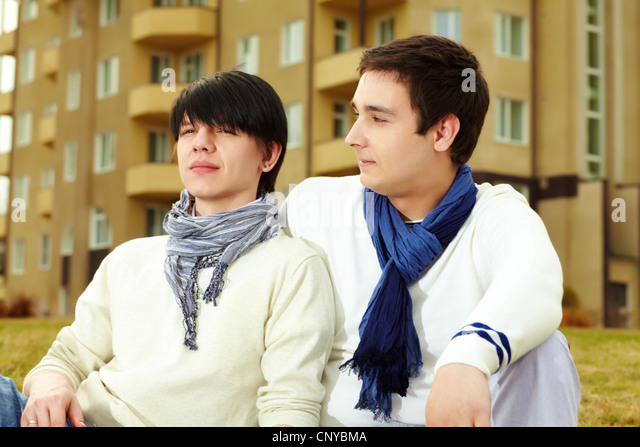 Close-up portrait of a homosexual couple spending time together outdoors - Stock-Bilder