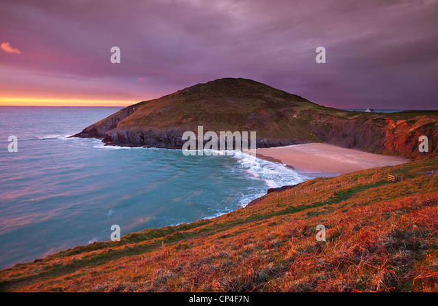 Sunset Mwnt beach and headland Cardigan bay Ceredigion coast Cardiganshire Wales UK GB EU Europe - Stock Image