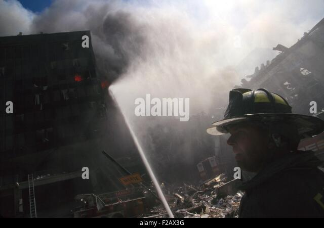 Fire fighter at World Trade Center site following September 11th terrorist attack. In the center background is the - Stock-Bilder