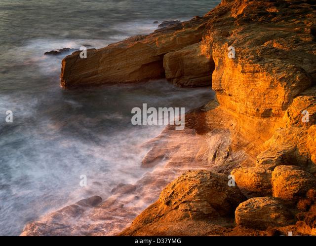 Rock formation and waves at Devil's Punchbowl, Oregon - Stock Image