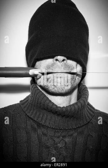 man hidden concept with a knife on his mouth - Stock Image